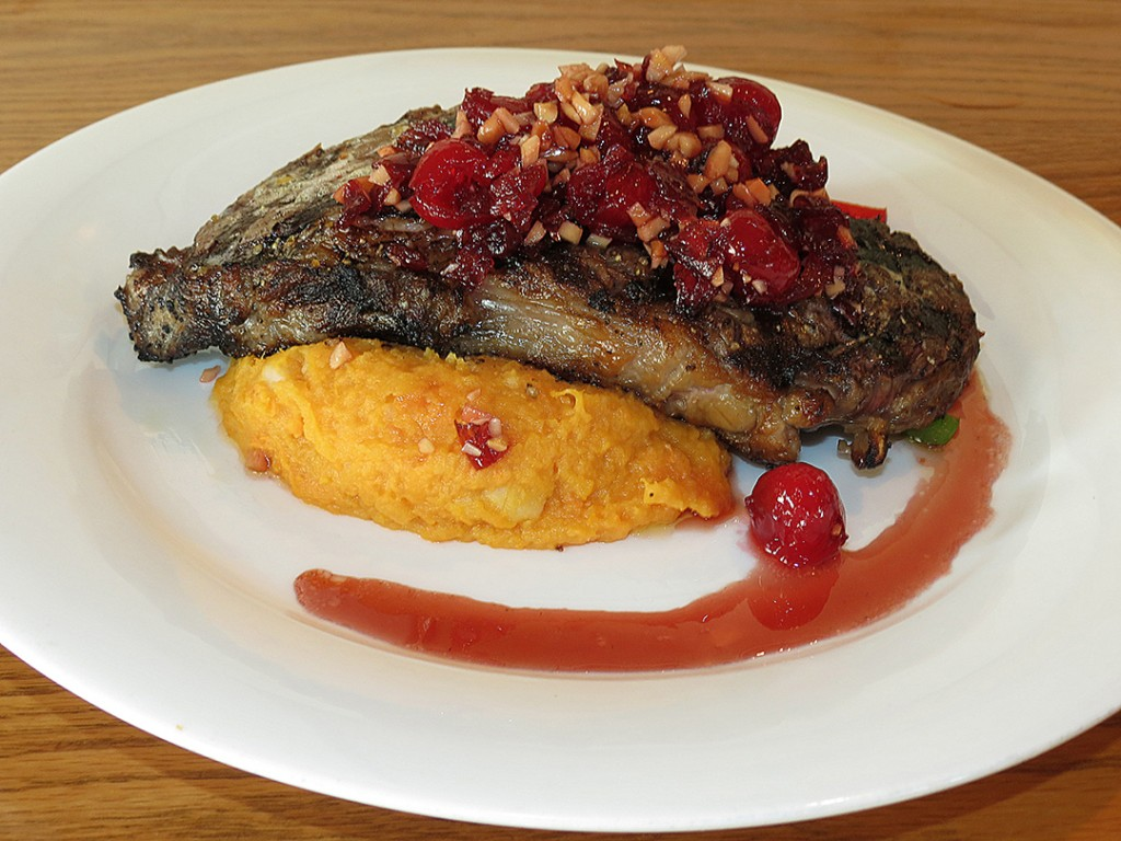 Coopers Corner Cherry Almond Strip Steak - 14oz N.Y. Strip with roasted sweet potatoes finished with a cherry almond compote.